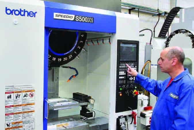 Worker using Brother Speedio CNC machine